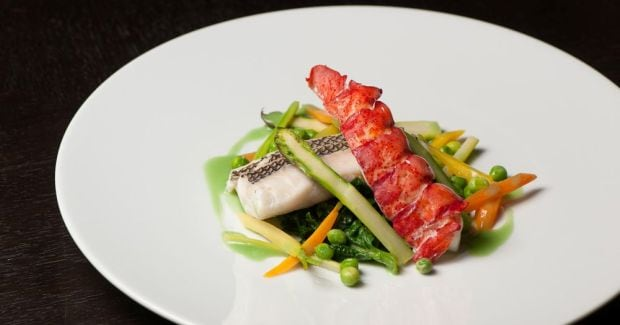 Michael Tusk's Steamed Black Bass with Lobster, English Peas, Fava Beans and Carrots