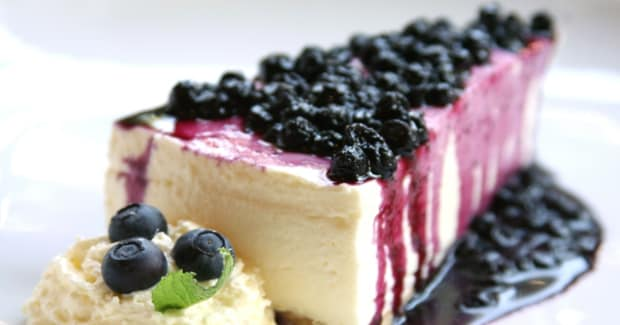 New York Cheesecake with Blueberry and Blackberry Drizzle