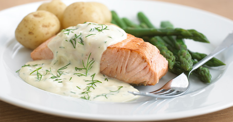Pan fried salmon with dill cream sauce and vegetables