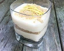 Layered lemon cheesecake with crunchy ginger crumbs
